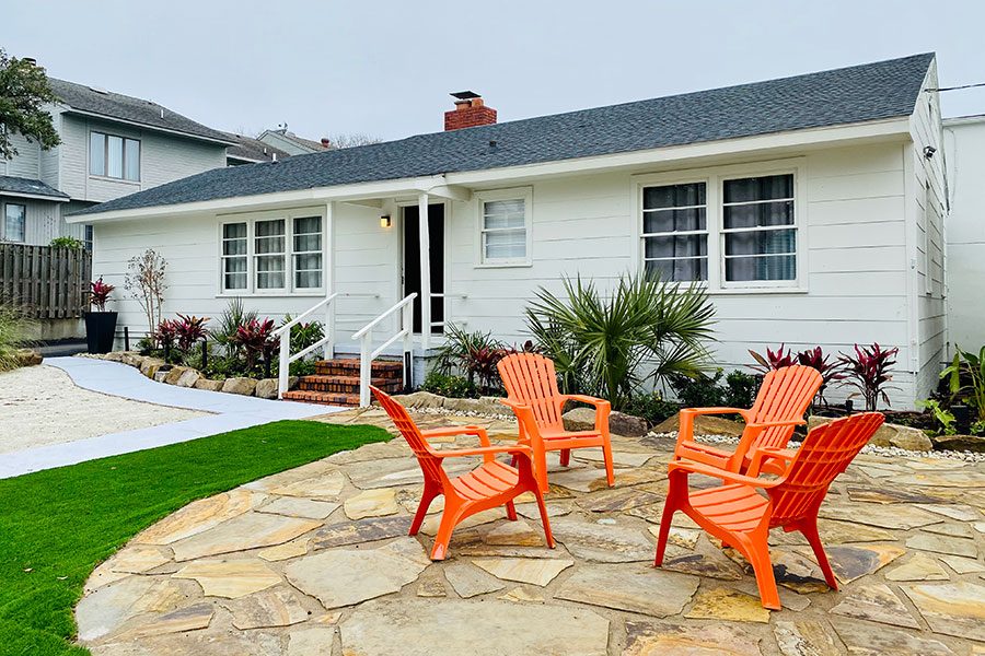 cottage exterior with 4 Adirondack chairs